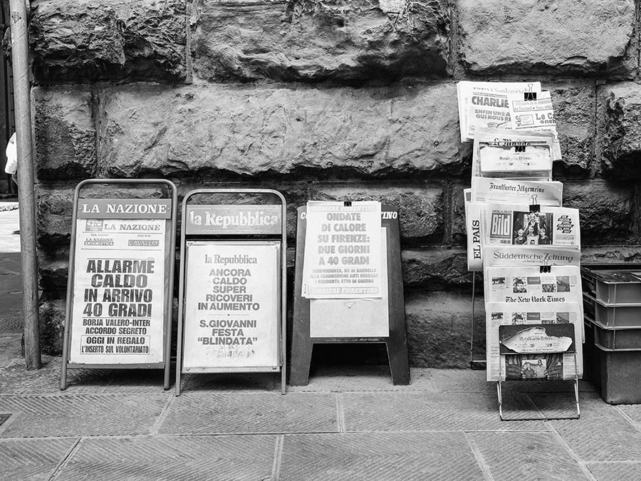 Black and white image of old newspaper stands